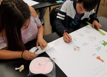 Students working on charts
